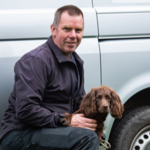 Dog Handler John Ashworth with Coco, Cocker Spaniel, in the grounds of St Nicholas Hospital