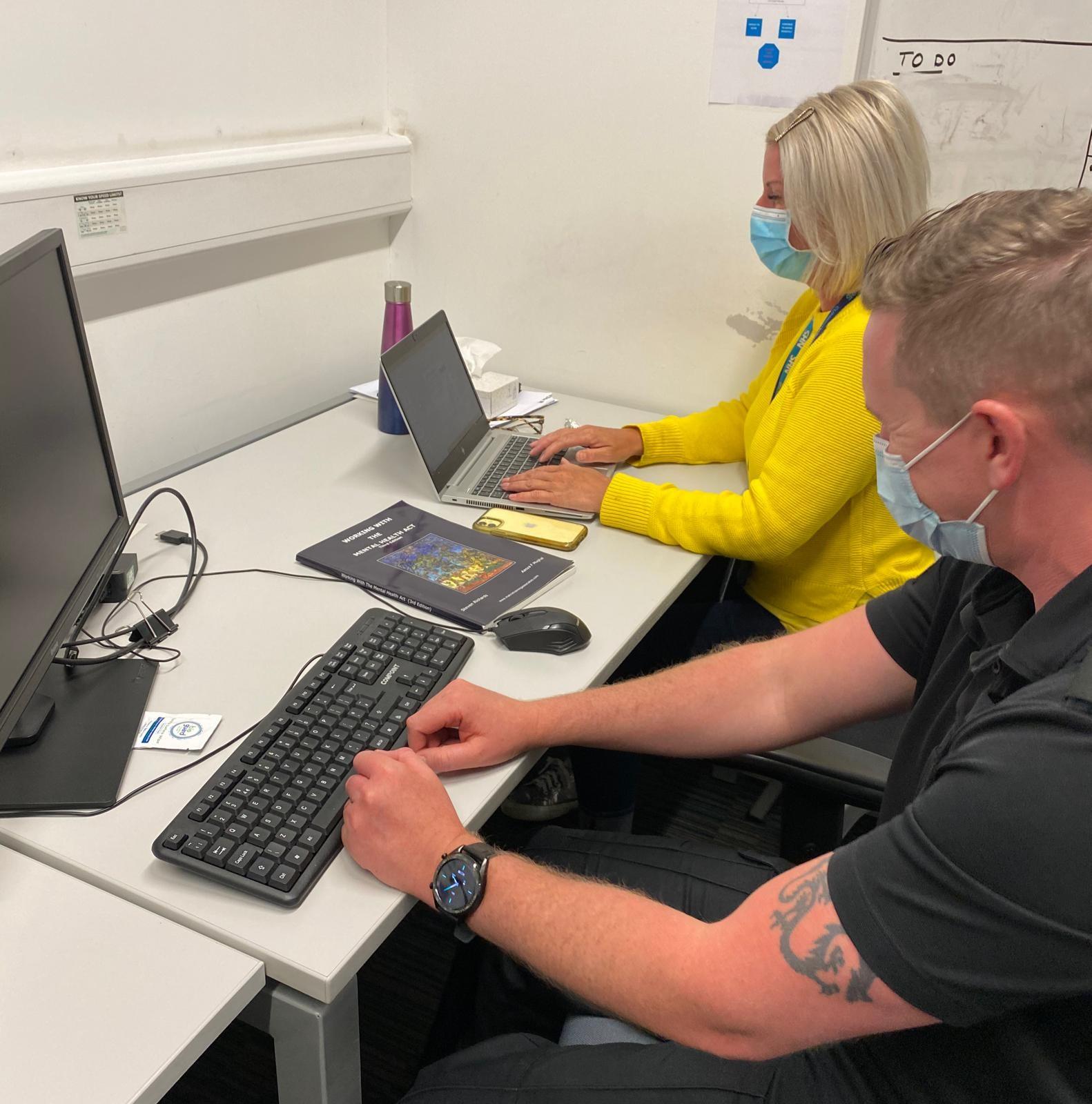 PC Chris Rudd and Registered Mental Health Nurse Deborah Mawson at a desk at the Street Triage Team's base.